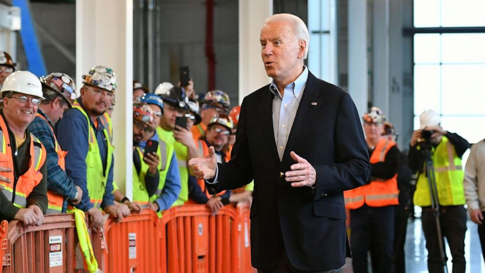 Biden gets in heated exchange on guns with auto worker